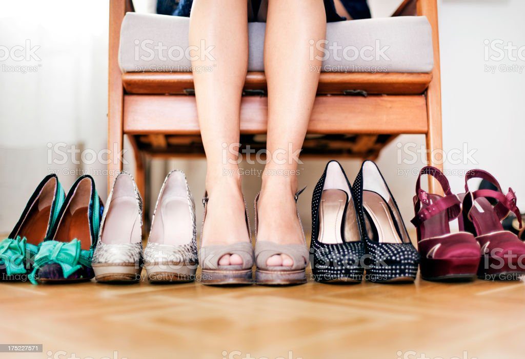Woman sitting on chair with shoes royalty-free stock photo