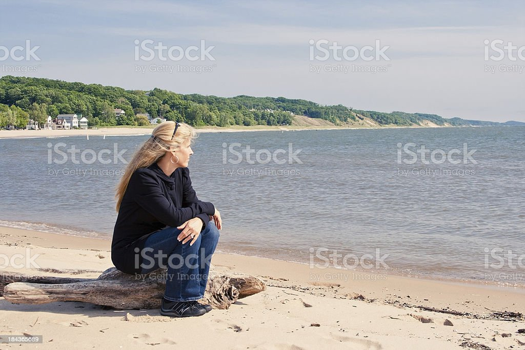 Woman Sitting on Coast royalty-free stock photo