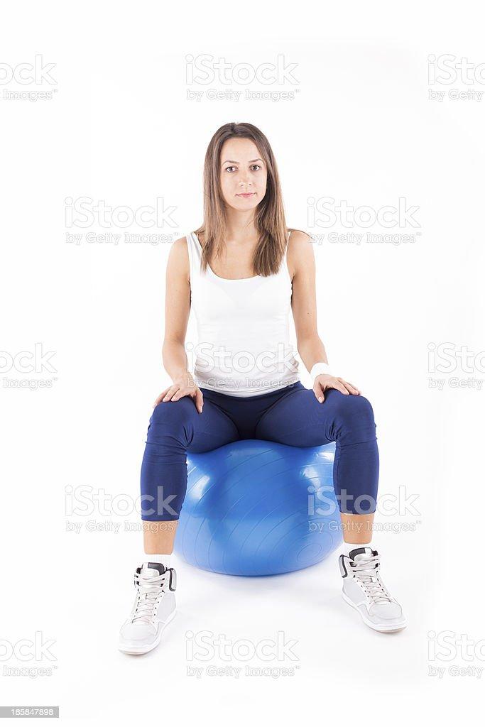 Woman sitting on fitness ball. stock photo