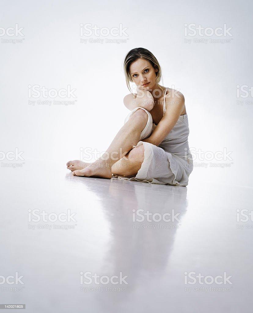 Woman sitting on floor stock photo