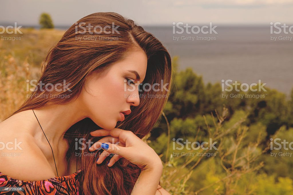 Woman sitting on hill royalty-free stock photo