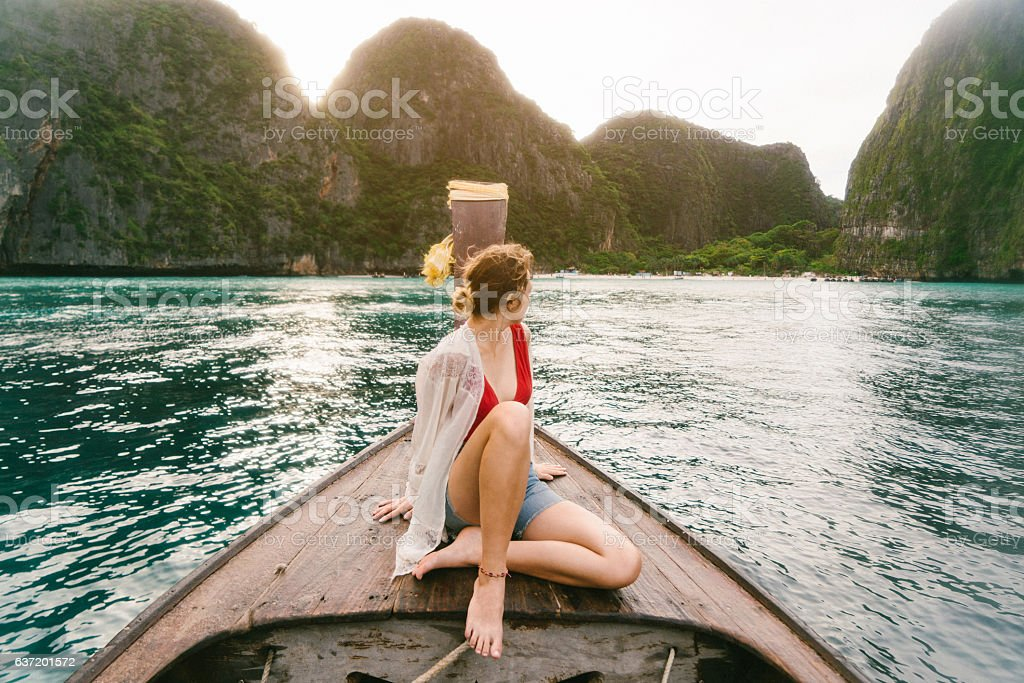 Woman sitting on long tail boat stock photo