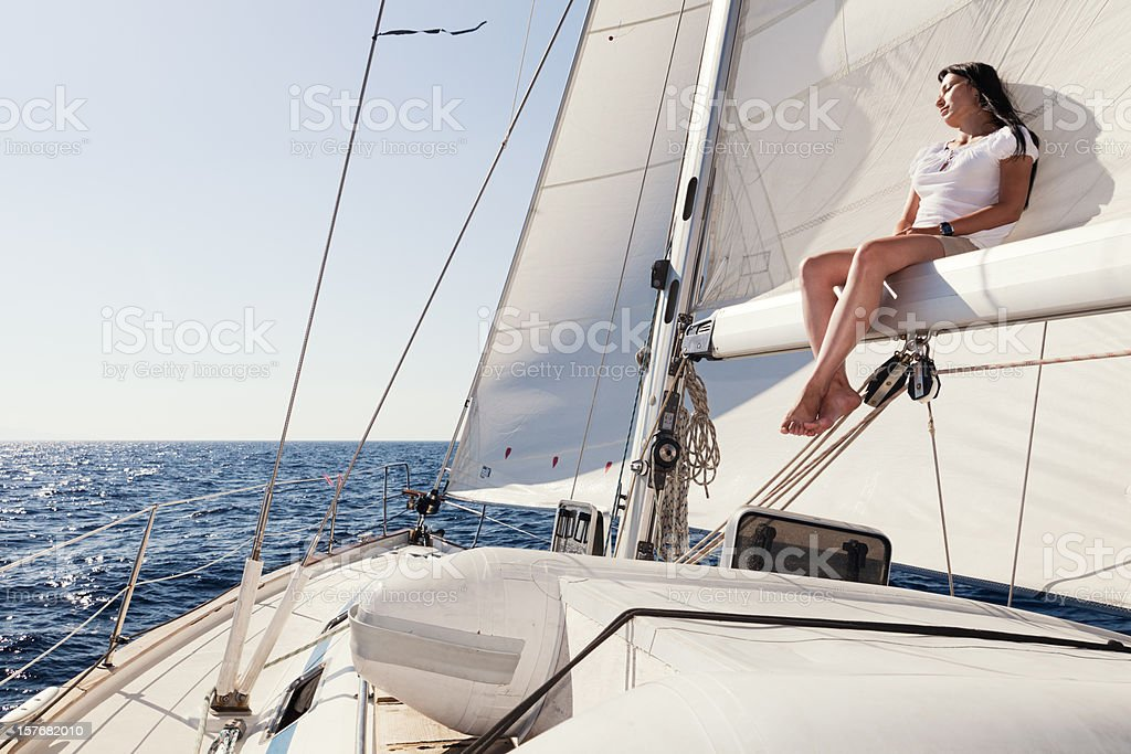 Woman Sitting On Main Boom royalty-free stock photo
