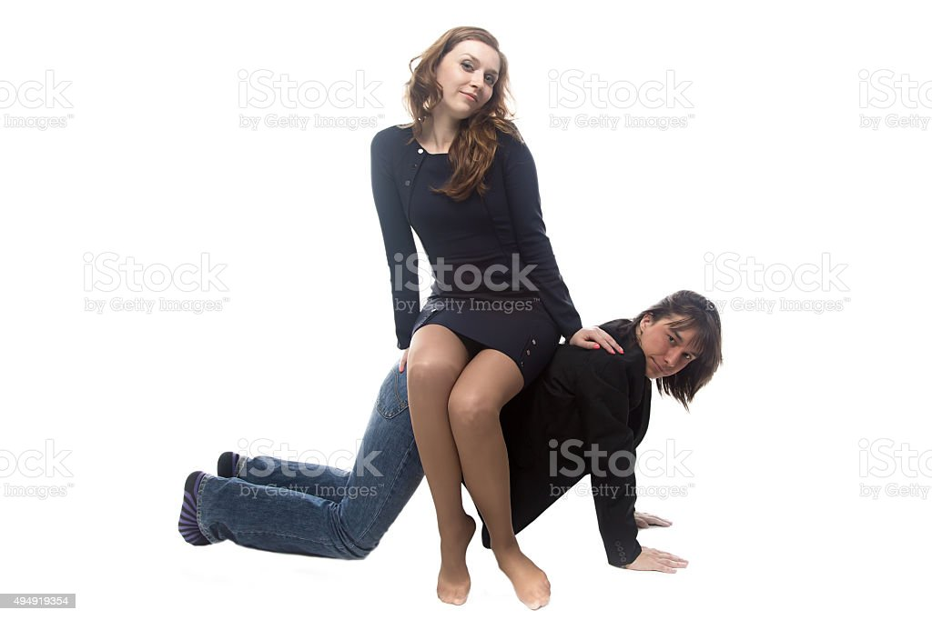Woman sitting on man in black jacket stock photo