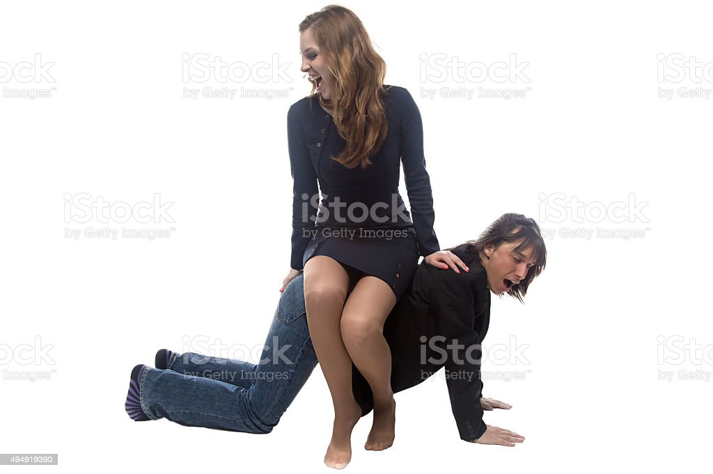Woman sitting on man in jacket stock photo