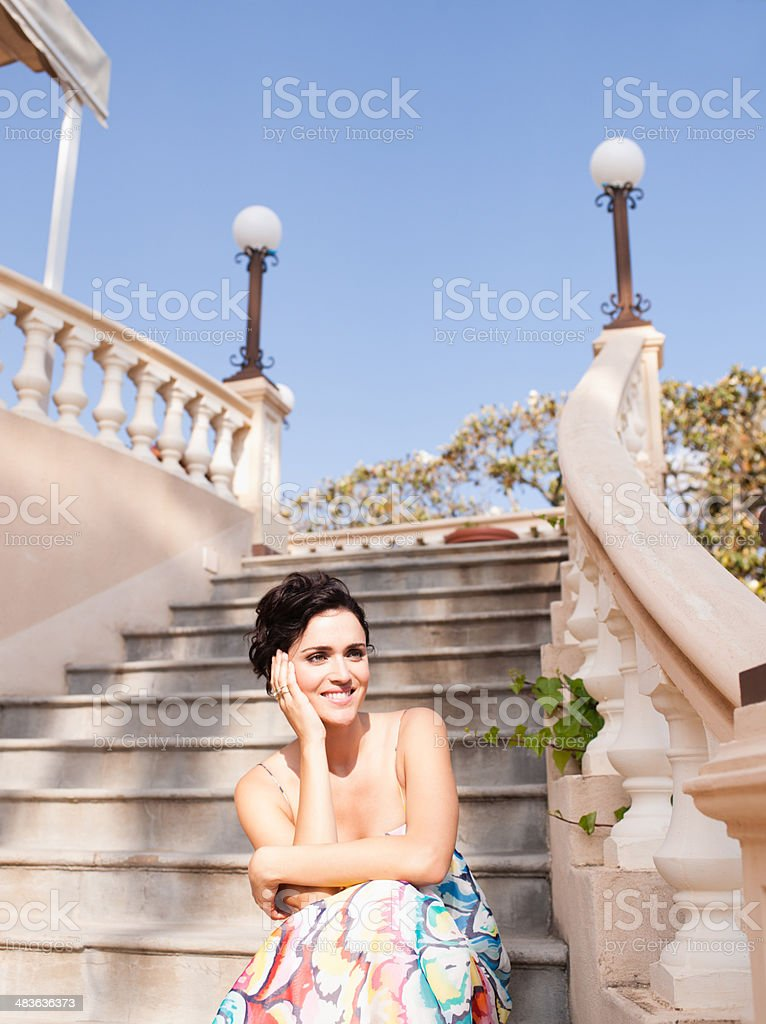 Woman sitting on outdoor staircase stock photo