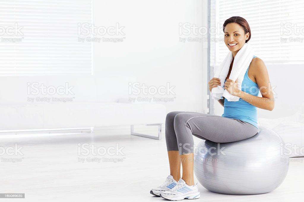 Woman Sitting on Pilates Ball royalty-free stock photo