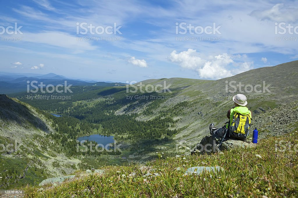 woman sitting on  rock  at mountain peak royalty-free stock photo