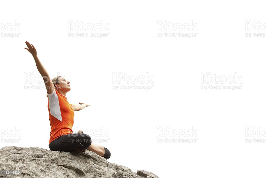 woman sitting on rock breathing in royalty-free stock photo