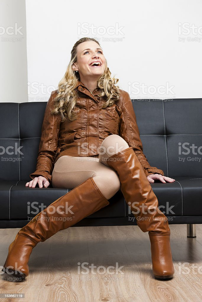woman sitting on sofa royalty-free stock photo