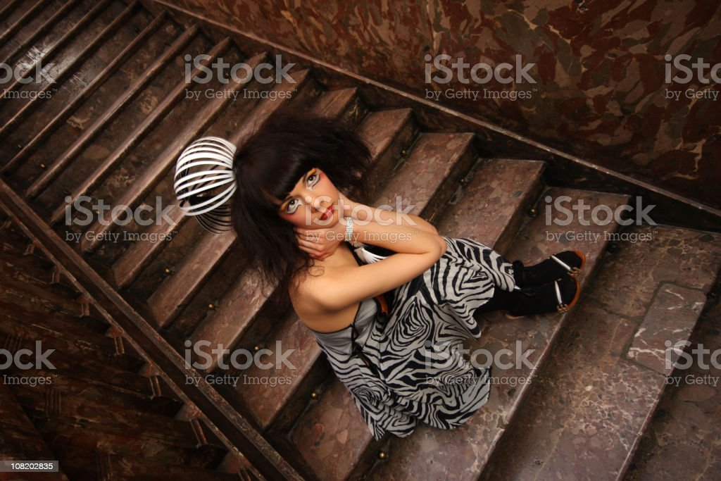 Woman Sitting on Staircase royalty-free stock photo