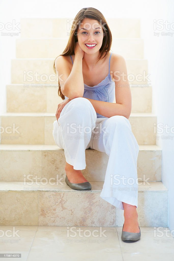 Woman sitting on stairs stock photo