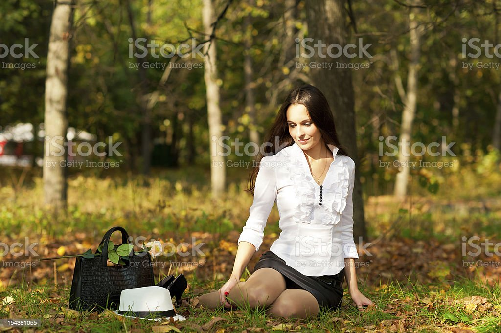 woman sitting on the ground royalty-free stock photo