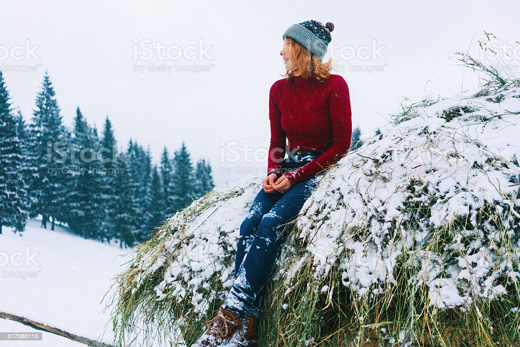 Woman sitting on the hay stock photo