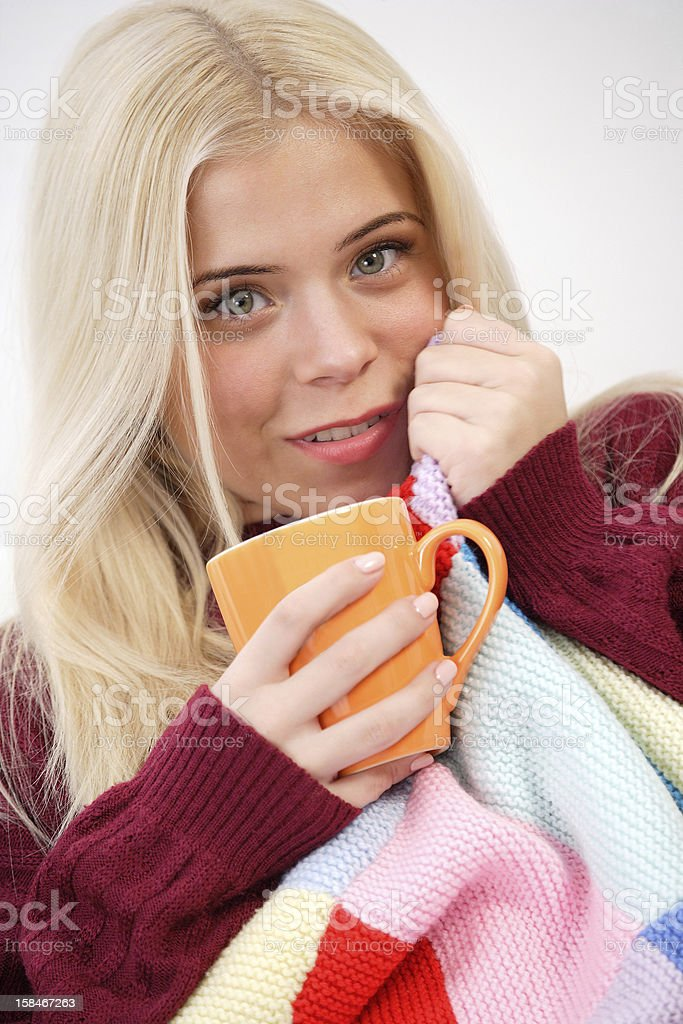 Woman sitting on the sofa, drinking tea royalty-free stock photo