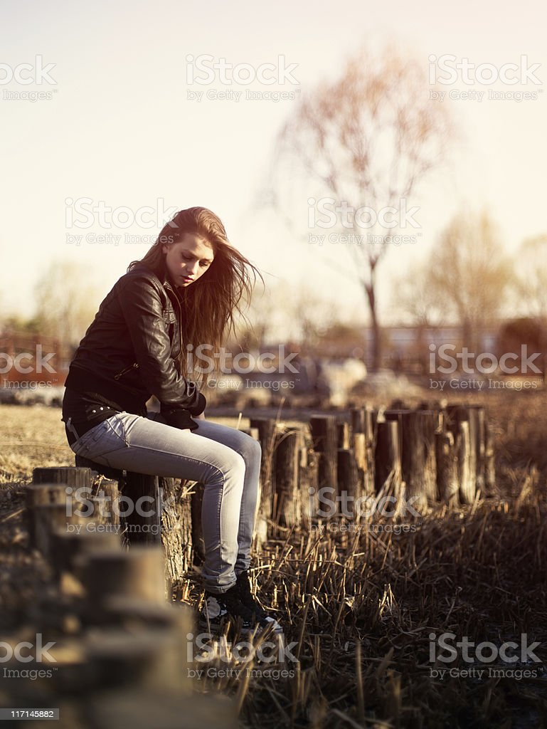 Woman sitting on the stumps stock photo