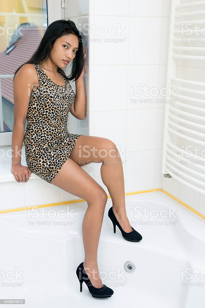woman sitting on the windowsil stock photo
