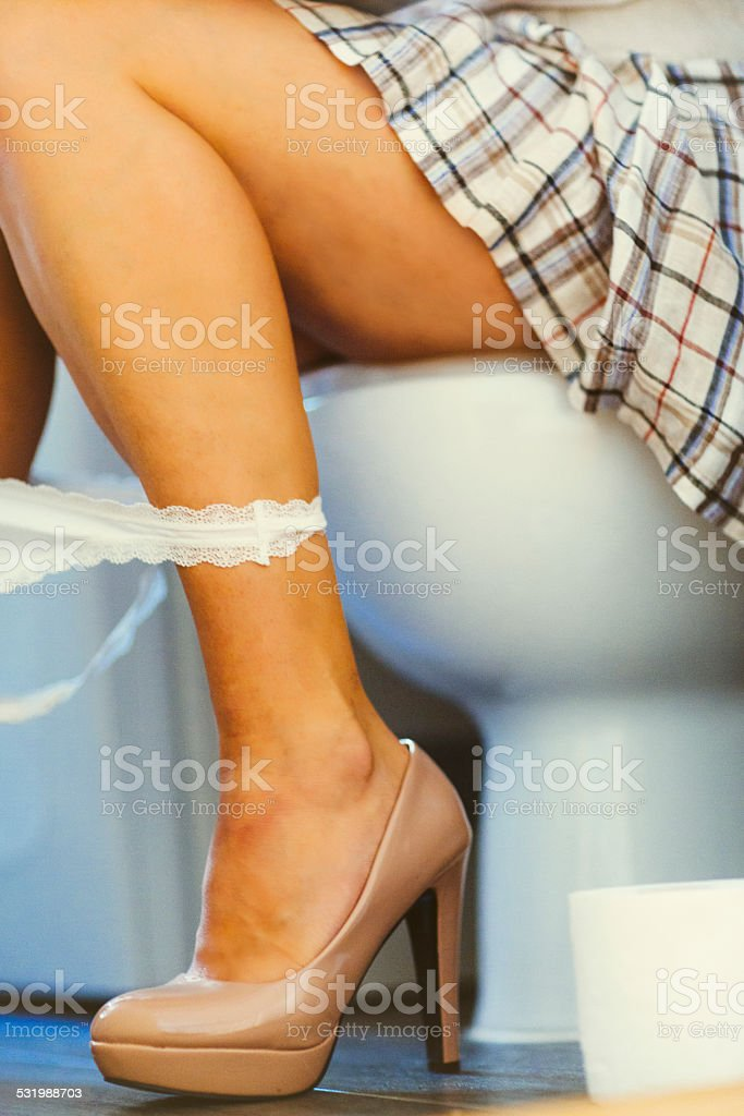 Woman Sitting On Toilet Seat stock photo 531988703 iStock