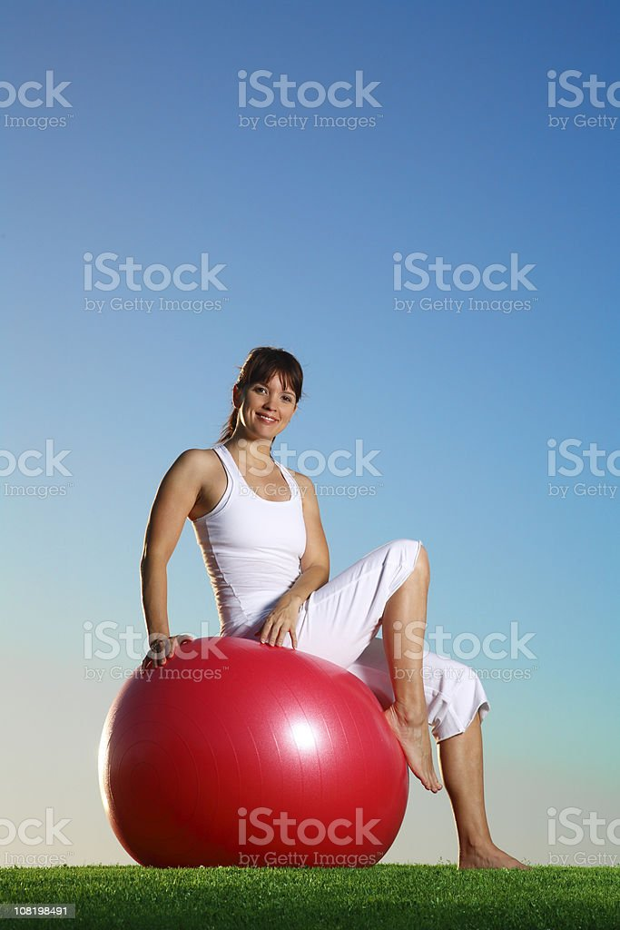 Woman Sitting on Yoga Ball royalty-free stock photo