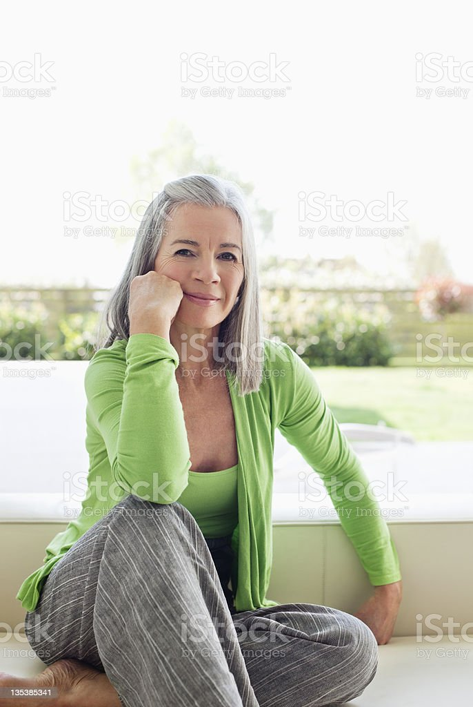 Woman sitting outdoors with head in hands royalty-free stock photo