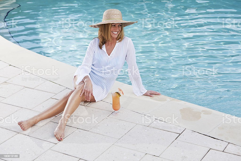 Woman sitting poolside royalty-free stock photo