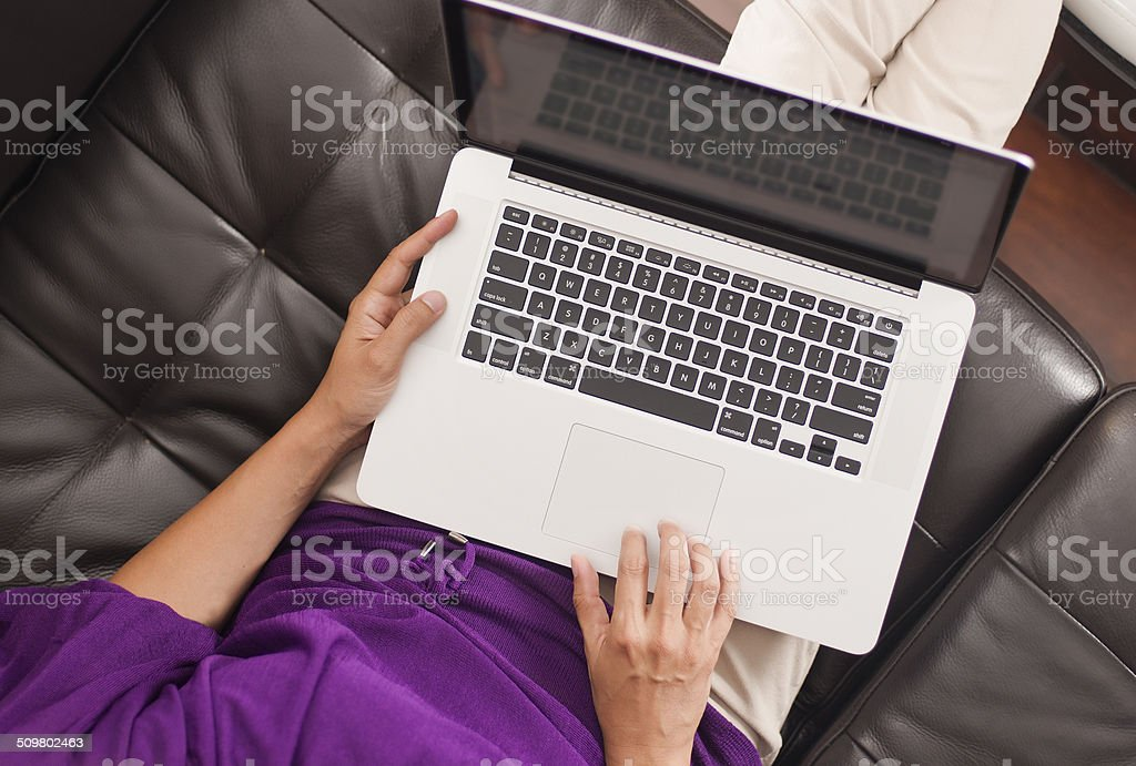 Woman sitting shopping online computer stock photo