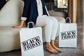 Woman sitting with bags.