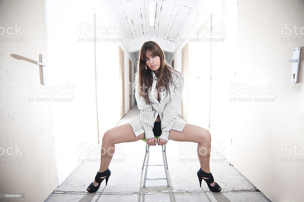Woman sitting with doors surrounding her stock photo