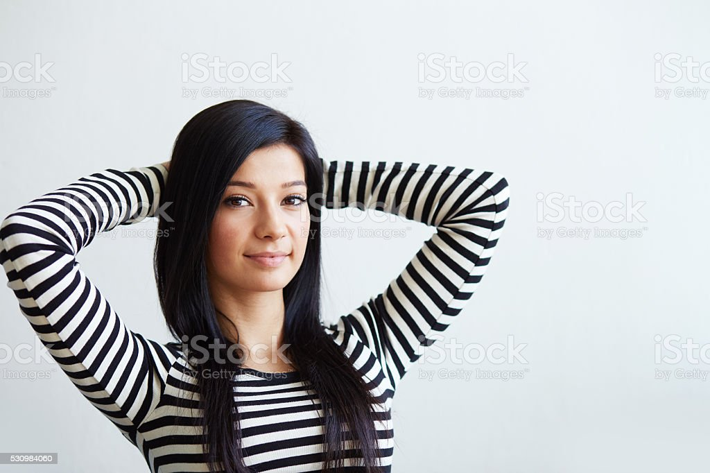 Woman sitting with hands behind head stock photo