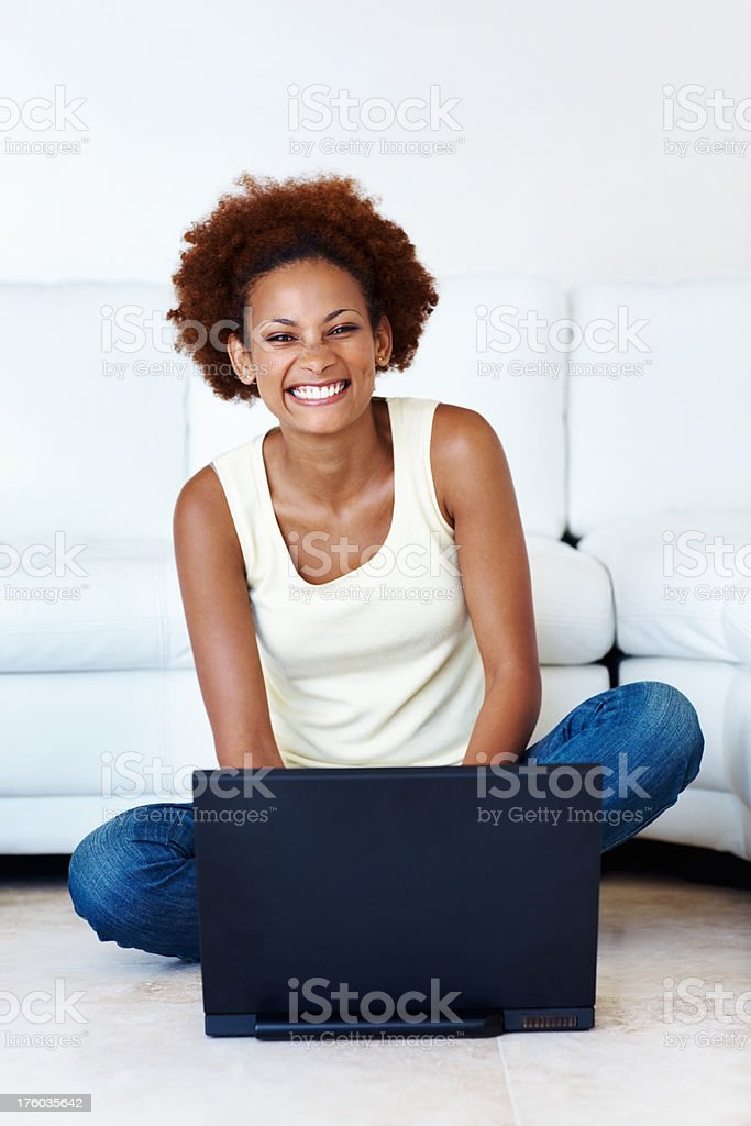 Woman sitting with laptop stock photo
