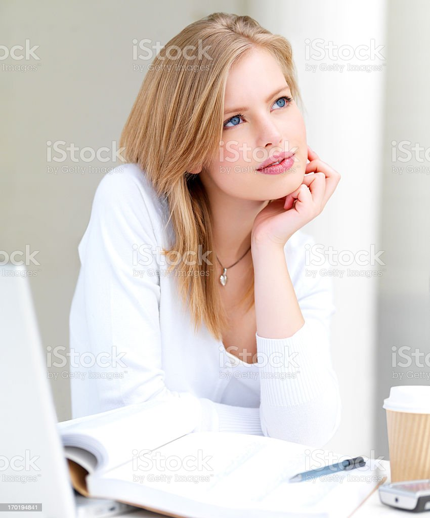 Woman sitting with notes stock photo