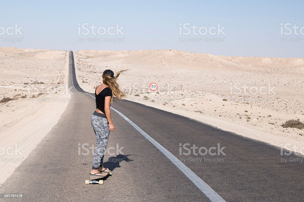 Woman skater in long road. stock photo