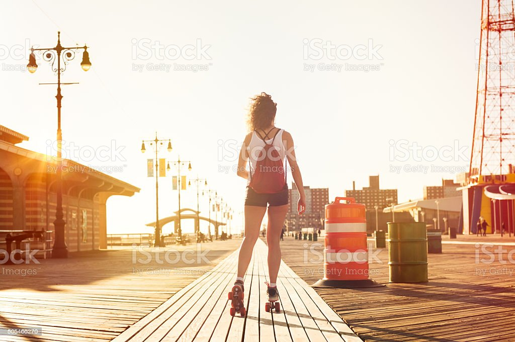 Woman skating on road stock photo