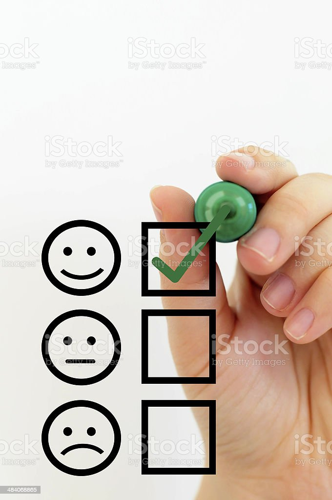 Woman Sketching Smiley Face stock photo