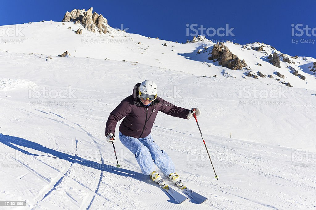 Woman Skier and Mountains royalty-free stock photo