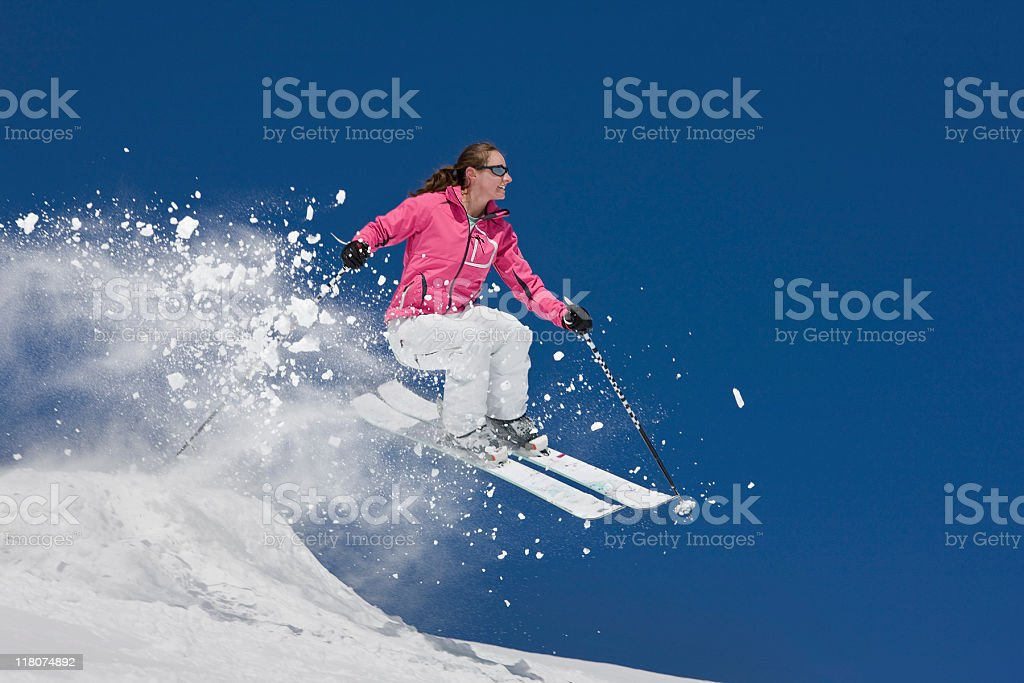 Woman Skier Caught In Mid-Air Jump royalty-free stock photo