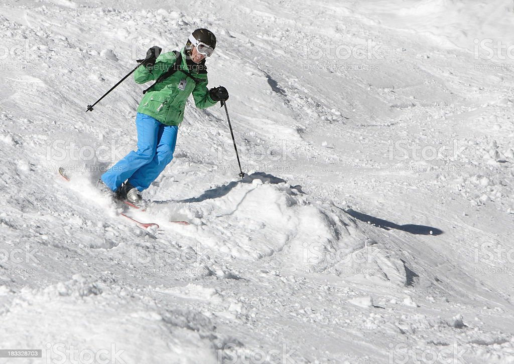 woman skier in green and blue stock photo