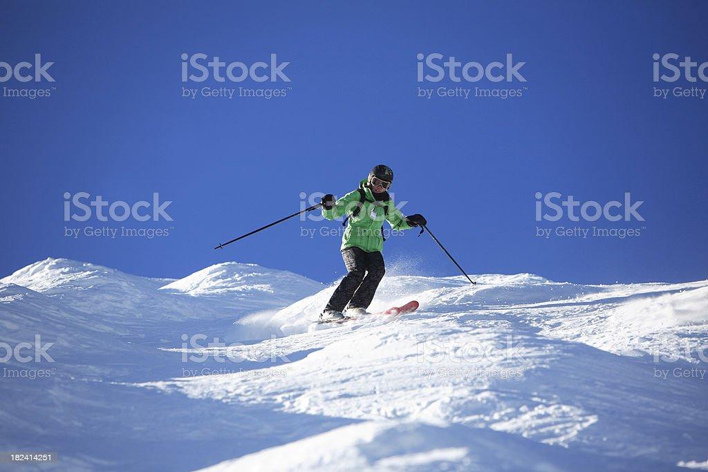 woman skier in moguls stock photo