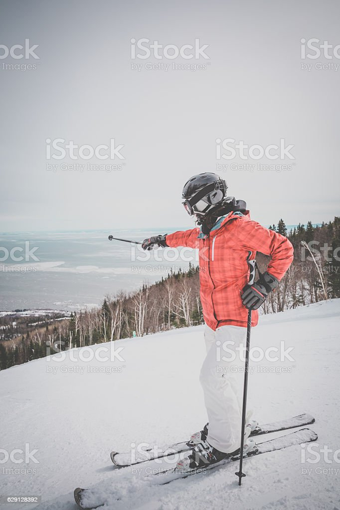 Woman Skier Posing on Mountain Summit stock photo