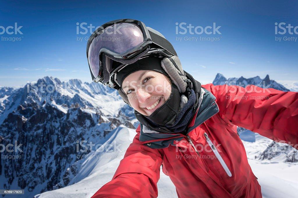 Woman Skier, Snowboarder Taking Selfie, Mont Blanc, Chamonix, Mont Blanc stock photo