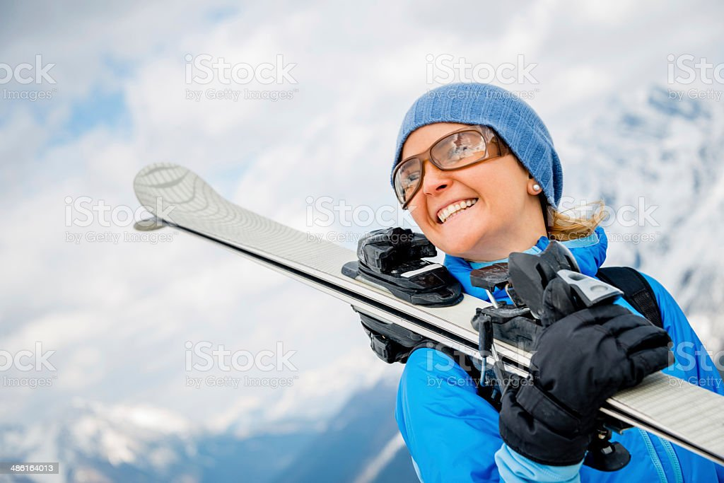 Woman skiing at wintertime stock photo