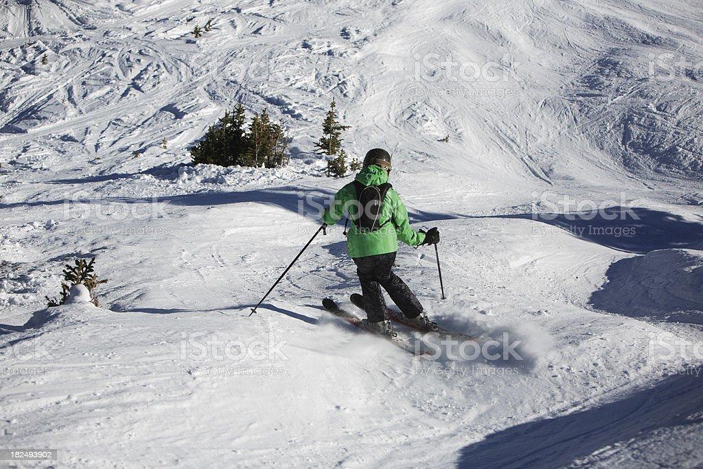 woman skiing down through moguls stock photo