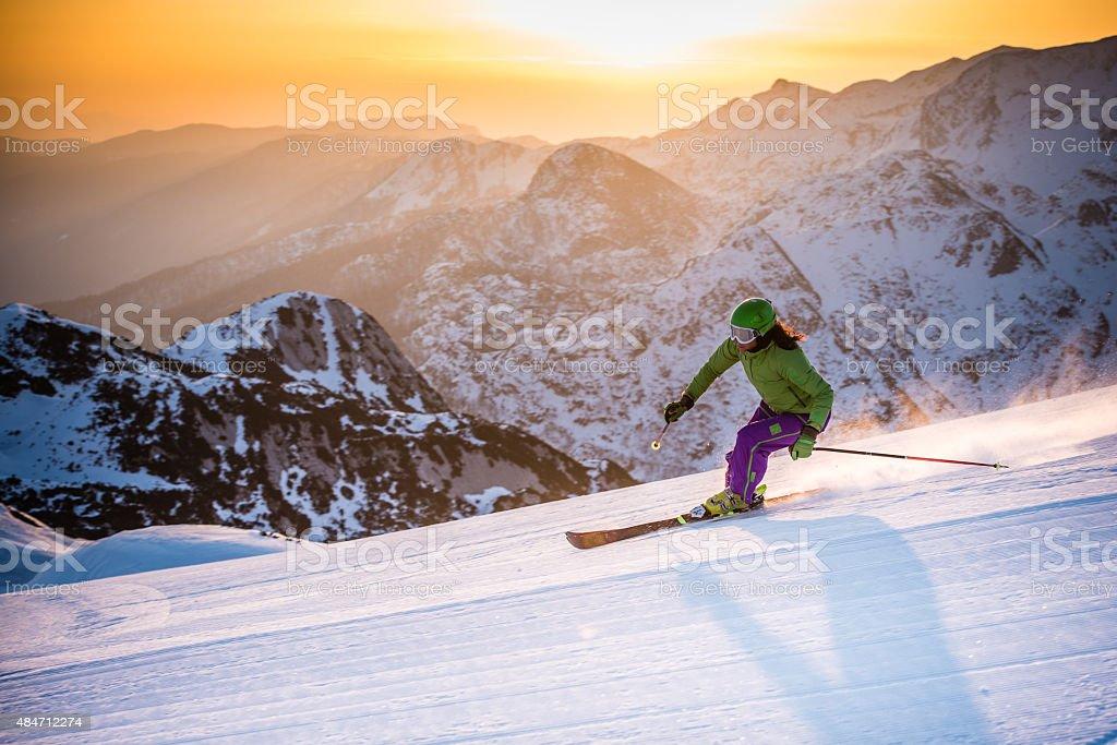 Woman skiing downhill stock photo