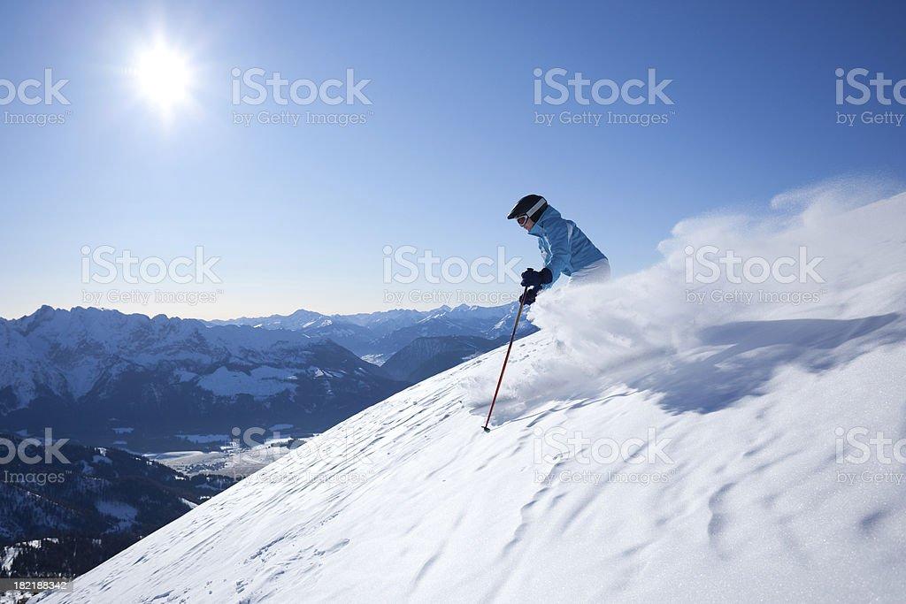 woman skiing in powder snow royalty-free stock photo