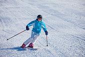 woman skiing on fresh prepared snow