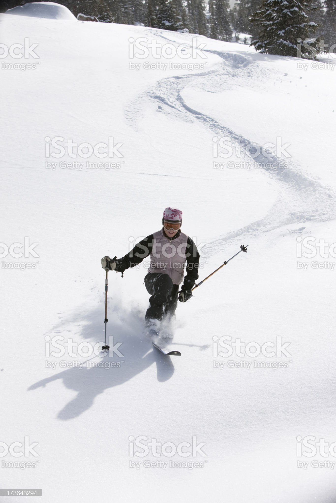 Woman skiing powder royalty-free stock photo