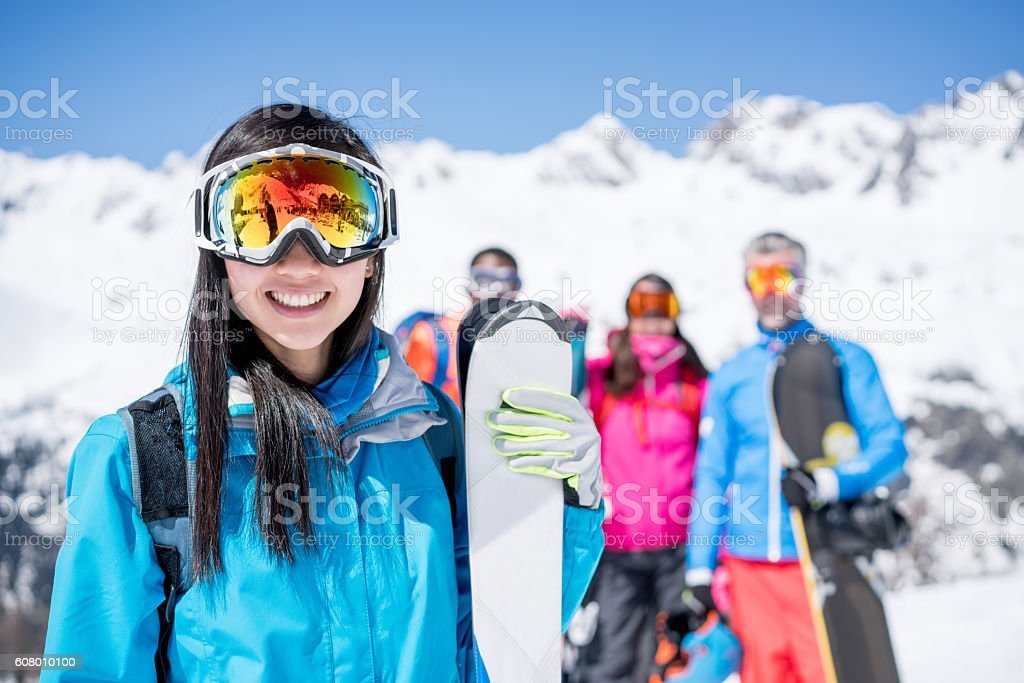 Woman skiing with friends stock photo