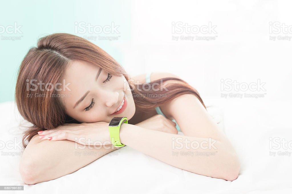 woman sleep with smart watch stock photo