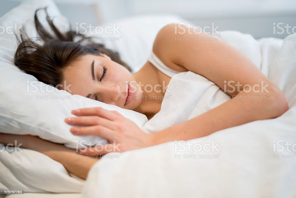 Woman sleeping at home stock photo