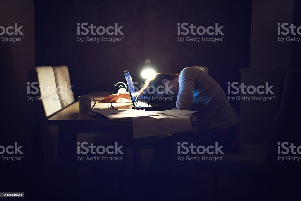 Woman sleeping at the desk stock photo